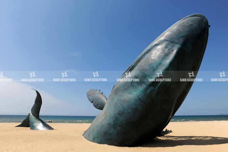 the completion of bronze whale sculpture