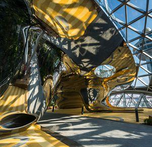 Discovery Slides, Large mirror polished seamless stainless steel facade sculpture,  Singapore